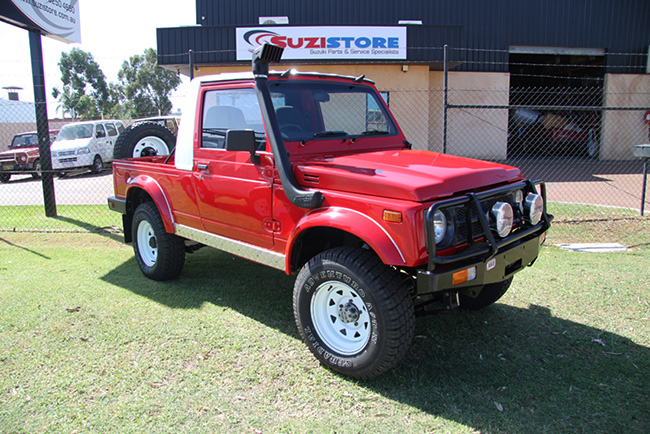 Total Rebuild for a Red Suzuki Utility Vehicle