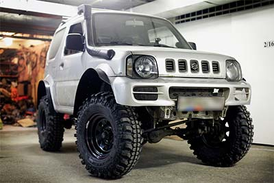 Suzuki Jimny with Lift Kit Installed from 4WD Part Shop